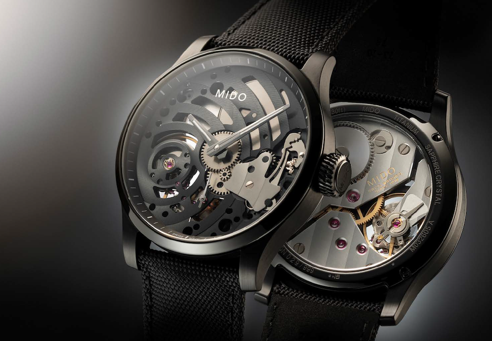 The dial-less Multifort Mechanical Skeleton Limited Edition, with a 44 mm diameter black PVD-treated titanium case, displays its skeleton movement (a first for Mido) with its hands integrated directly into the black plate decorated with Côtes de Genève. Limited series of 999 numbered pieces.