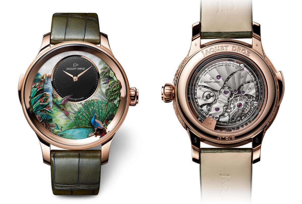 The Tropical Bird Repeater model with hand-engraved and hand-painted white mother-of-pearl dial and black onyx subdial. Automaton animation with peacock, tropical leaves, hummingbird, toucan, dragonflies and waterfall.