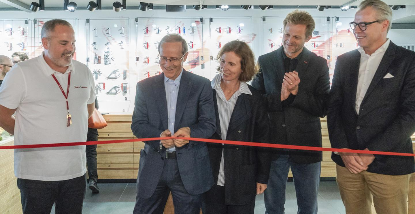 Carl Elsener Jr. (centre), at the opening of the new store. He represents the fourth generation running Victorinox.