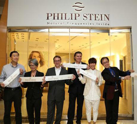 Will Stein, founder and president of the Philip Stein Group (third from right), celebrates the opening of the store with friends of the brand