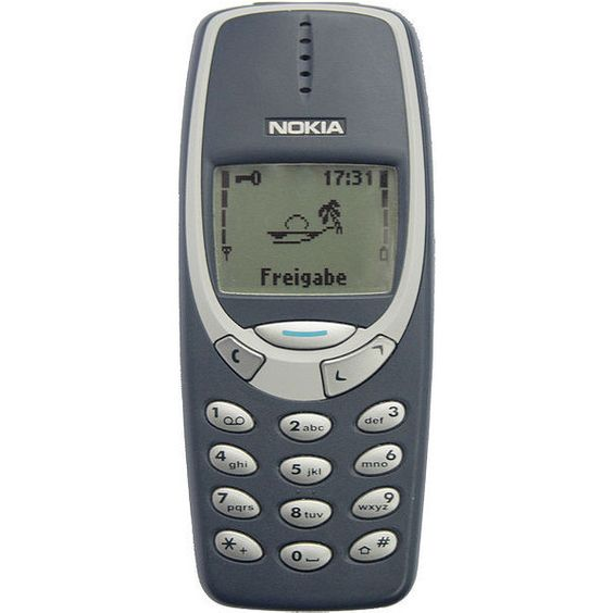 Nokia 3310 with the clock on the top right corner of the screen