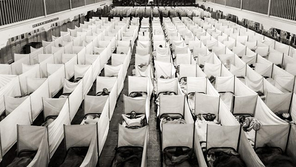 "Containment zone in a barracks in San Francisco. Beds are equipped with ""anti-sneeze"" walls. 1918."