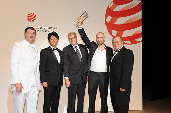 "Ventura CEO Pierre Nobs, third from left, and designer Simon Nusslein, second right, with their red dot design ""Best of the Best"" award"