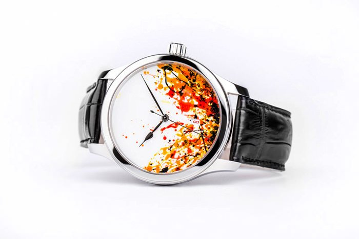 The dial by Tolli is painted by hand depicting Fire and Volcanic Eruption