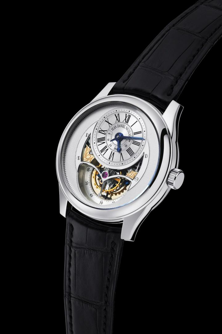 Jean Daniel Nicolas Two-Minute Tourbillon. Hour hand, minute hand, seconds indicated by the tourbillon. Power reserve of more than 60 hours shown by an indicator hand.