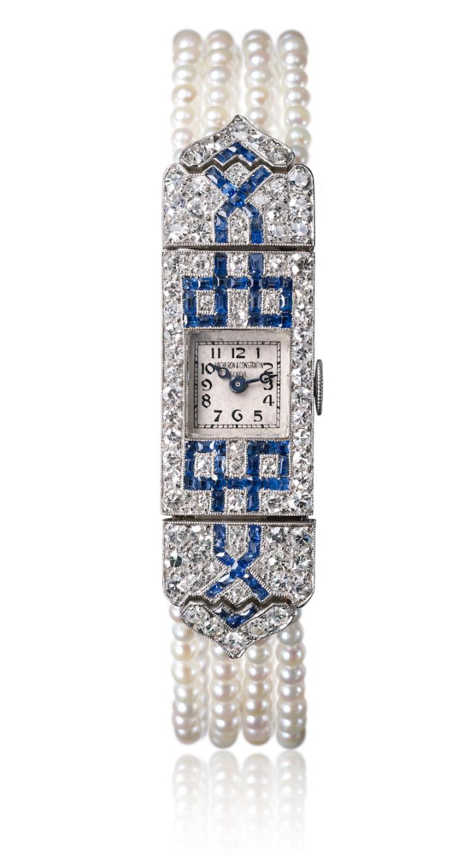 Vacheron Constantin, lady's wristwatch in white gold, baguette-cut sapphires, single-cut diamonds, millegrain decoration, pearl bracelet, 1920