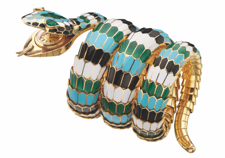 Bulgari Serpenti bracelet watch in golds with polychrome enamel dial and emeralds, 1967