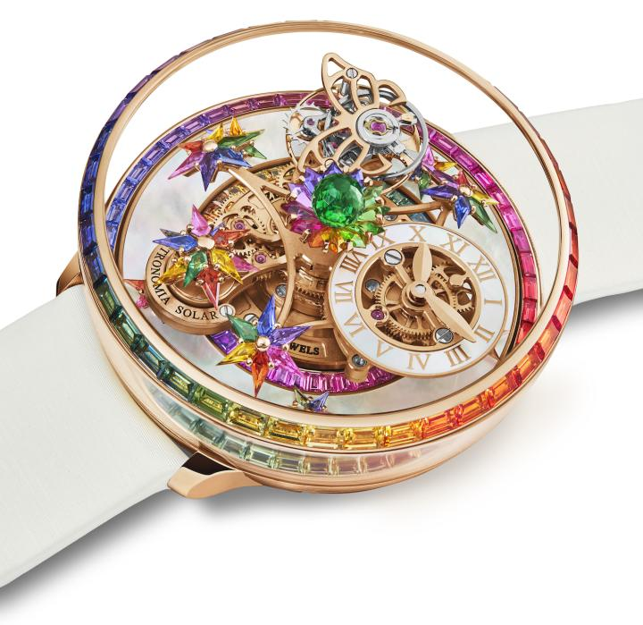 The 18K rose gold bezel of the Astronomia Fleurs de Jardin Rainbow is set with 40 rainbow sapphires, while the inner ring features 48 rainbow sapphires. Sitting on top of the movement is a green 288-facet Jacob-cut tsavorite. The frame carrying 11 flowers with kite-shaped multicoloured sapphires takes ten minutes to perform a complete rotation around the dial.