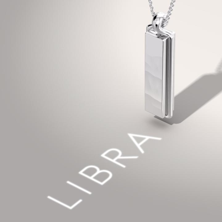 A white gold pendant made in collaboration with the Sang Bleu studio