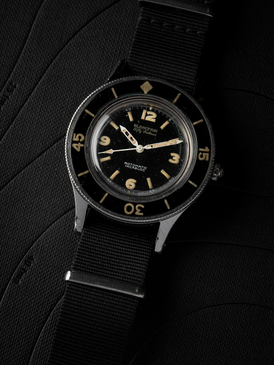 A Blancpain Fifty Fathoms. The ISO 6425 standard launched in 1996 took as inspiration some of the specifications and requirements of the Blancpain Fifty Fathoms