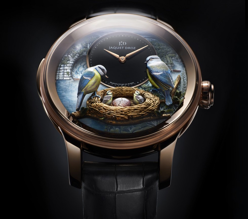 The Bird Repeater was the first wristwatch automaton, introduced by Jaquet Droz in 2012. It represents a pair of blue tits, a symbol of Pierre Jaquet-Droz's native Jura region, over a nest containing their fledglings. No fewer than eight different animation mechanisms act synchronously.